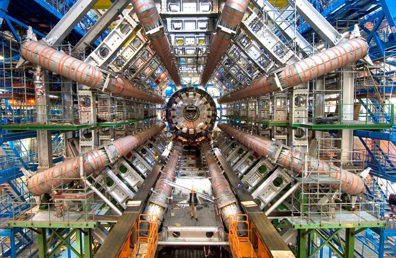 Interior of the Large Hadron Collider at CERN, Geneva: This magnificent sight is testimony to the mind of man and its brilliant ability to build a machine that can ape the moment one trillionth of a second after the universe began, as well as the confidence to switch it on in spite of the fact that no one has any real idea what will happen, but this courage and determination to explore the unknown may establish the existence of the Higgs boson to complete the Standard Model and the existence of extra dimensions needed to produce micro Black Holes and thus vindicate the popular author Brian Greene and his fellow string theorists, who otherwise have nothing in nuclear physics yet to back their speculations, keep their positions and win them a Nobel prize, but who of course are not influenced at all by any of that in supporting CERN in dismissing the chances of universal catastrophe as zero, and the critics' equally expert papers as not worth reading.