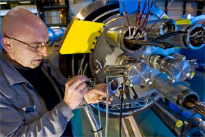 CERN scientist hard at work repairing the LHC, where one of the 7200 or so scientists employed was taken off the job and accused of contacting Al Quaeda a few weeks ago.