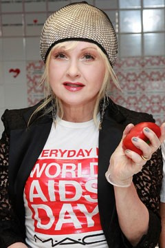 Cyndi Lauper is now the new pin up girl for HIV-AIDS victims, helping spread the word to attract funding so that they can take purposeless and dangerous drugs which will eventually kill them, according to HIV-AIDS critics.